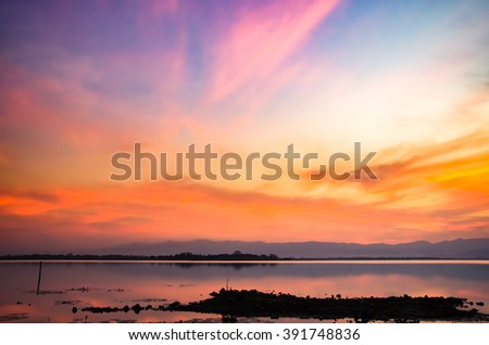 Colorful sunset sky with orange clouds. - stock photo