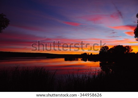 colorful sunset sky with reflection on the water