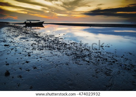 Colorful sunset with old fisherman boat, Java, Indonesia