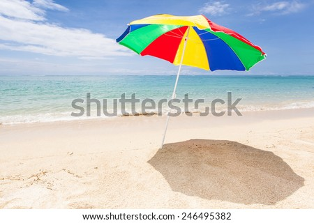 colorful sunshade at a lonesome tropical beach, Le Morne, Maurtius, Africa - stock photo