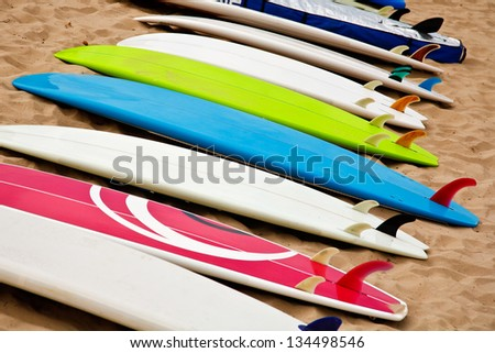 Colorful surf boards on the beach - stock photo