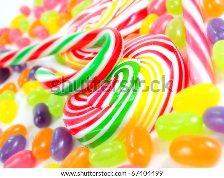colorful sweet lollipop candy cane and jelly bean - stock photo