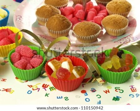 Colorful sweets for children on the kinder party - stock photo