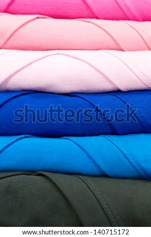 colorful T-shirts, the stacked - stock photo