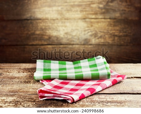 colorful tablecloth on old wooden table - stock photo