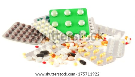 Colorful tablets scattered on a white background