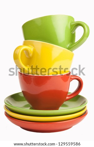 Colorful tea cups and saucers, isolated on white.