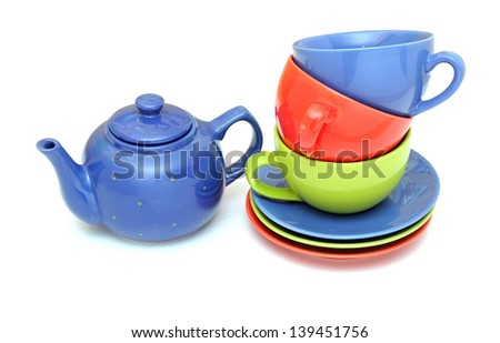 colorful tea cups with teapot isolated on white - stock photo