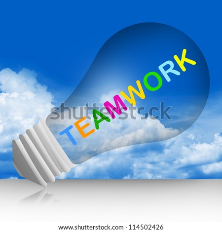 Colorful Teamwork Text Inside The Light Bulb For Business Concept in Blue Sky Background