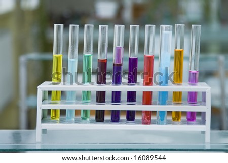 Colorful test tubes containing different solutions in a laboratory.