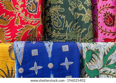 Colorful textile in store - stock photo