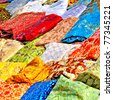 colorful textile in tunisian market - stock photo