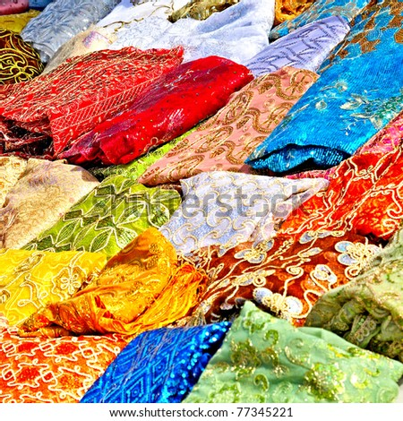 colorful textile in tunisian market - stock photo