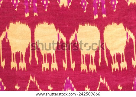 Colorful Thai fabric pattern as background. - stock photo