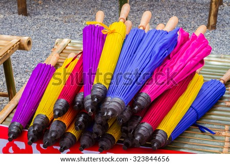 colorful Thai folded bamboo umbrella sold in the market.