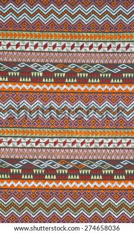 Colorful thai handcraft peruvian style rug surface close up. More of this motif & more textiles peruvian stripe beautiful background tapestry persian nomad detail pattern arabic fashionable textile. - stock photo