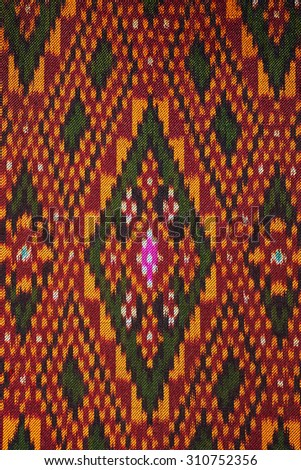 Colorful thai silk handcraft peruvian style rug surface close up More this motif & more textiles peruvian stripe beautiful background tapestry persian nomad detail pattern farabic fashionable textile.