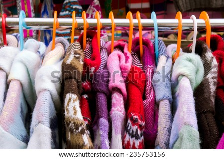 Colorful thick warm winter coats at a market - stock photo