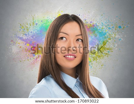 Colorful Thinking. Business woman against gray background and colorful splashes - stock photo