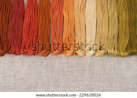 Colorful Threads Set. Natural Linen Background. - stock photo