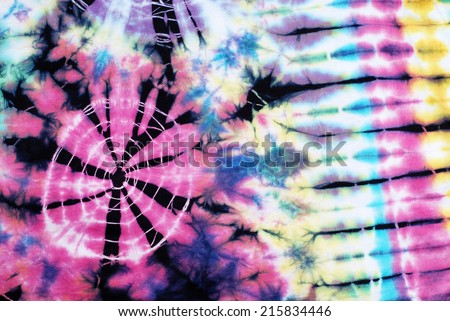 colorful tie dyed fabric background  - stock photo