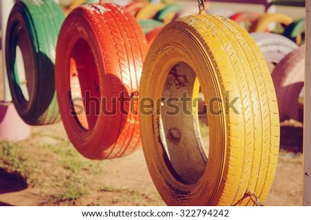 Colorful Tires Playground,children painted. - stock photo