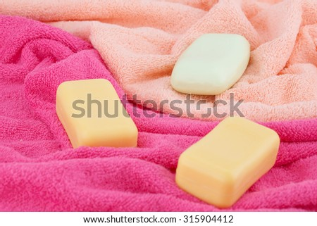 Colorful towels and soaps closeup picture. - stock photo