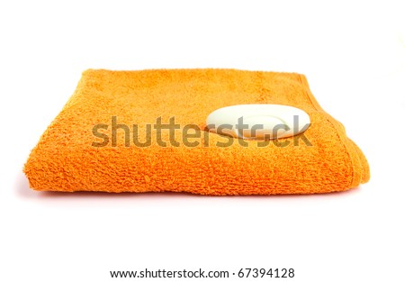 Colorful towels o white background - stock photo