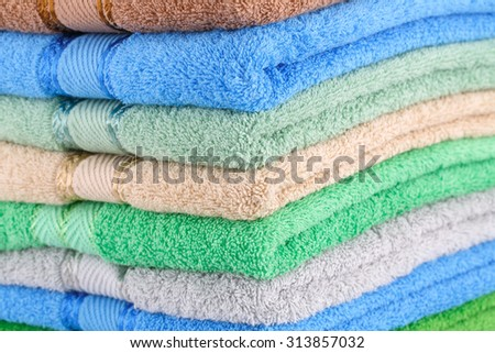 Colorful towels stack closeup picture. - stock photo