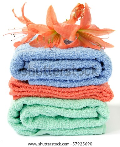 Colorful towels with fresh wild flowers - stock photo