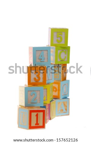 Colorful toy blocks with numbers for the study of numbers and mathematics for pre-school children/Baby cubes for game isolated on white - stock photo