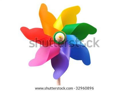 Colorful toy pinwheel windmill on white background, space for copy - stock photo