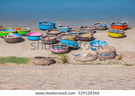 Colorful traditional boats in fishing village, Mui Ne, Binh Thuan Province, Vietnam, Southeast Asia. Round basket boats, Thung Chai. Sea shore. Popular asian landmark, famous destination of Vietnam