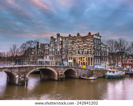 Colorful traditional canal houses on the corner of brouwersgracht and Prinsengracht in the UNESCO World Heritage site of Amsterdam - stock photo