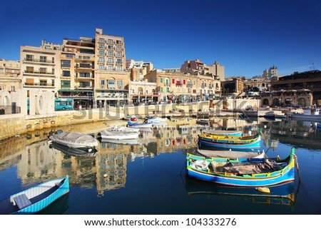 Colorful, traditional fishing boats in the mediterranean island of Malta. - stock photo
