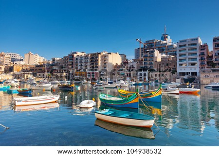Colorful traditional fishing boats in the mediterranean island of Malta. - stock photo