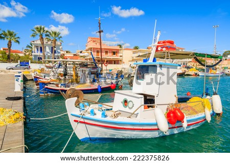 Colorful traditional Greek fishing boats in port of Lixouri town, Kefalonia island, Greece  - stock photo
