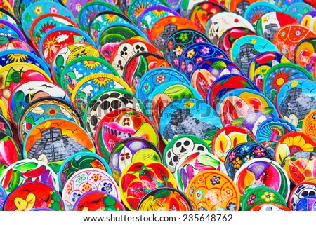 Colorful traditional mexican ceramics on the street market - stock photo