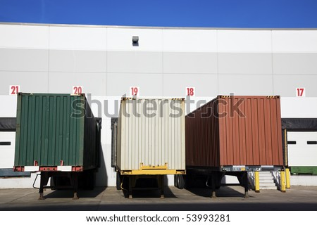 Colorful Trailers in front of the warehouse. - stock photo