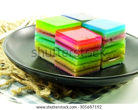 colorful treat of rainbow layered gelatin dessert - stock photo