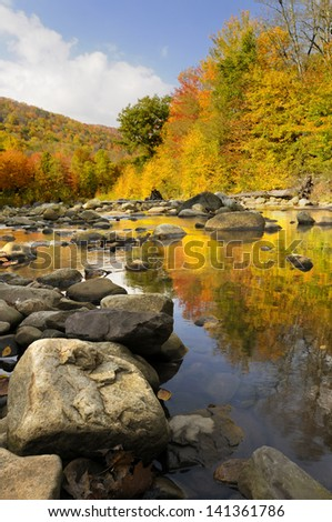 Colorful Trees Reflected in Stream - stock photo