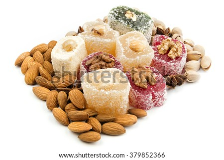Colorful Turkish sweets and nuts arranged on white background