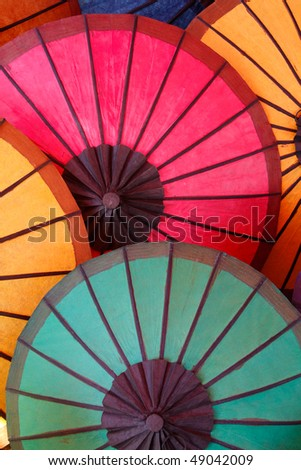 Colorful umbrella sold on the night market in Luang Prabang / Laos