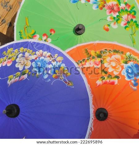 colorful umbrellas, Borsang umbrella and Thai handicraft village ,Borsang ,Chiangmai,Thailand - stock photo