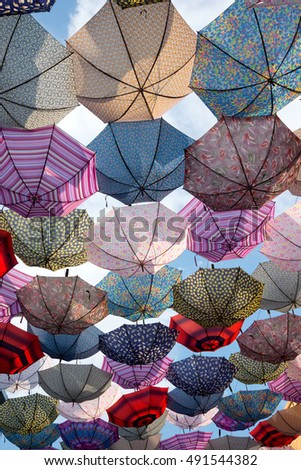 Colorful umbrellas flying in the sky