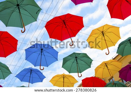 colorful umbrellas in the sky - stock photo
