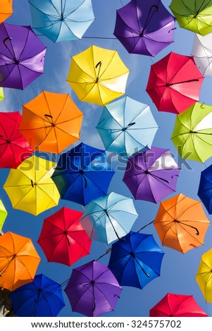 colorful umbrellas in the sky, street decoration  - stock photo