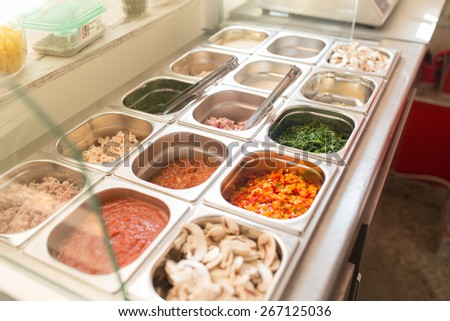 Colorful variety of ingredients in a food bar - stock photo