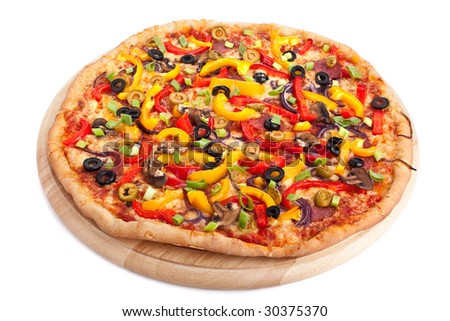 colorful vegetable pizza on a round wooden chopping board