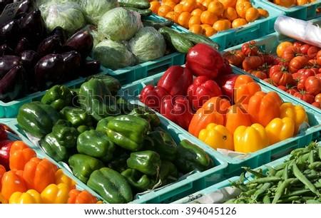 Colorful vegetables in street market, vegetable background, street market. Sunday market in Marsaxlokk, Malta. Cabbage, paprika, aubergine in street market - stock photo